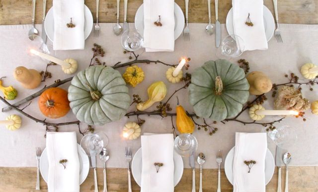 Table with large pumpkins